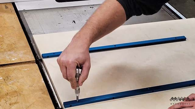 attaching the runners to the cross cut sled with a center punch