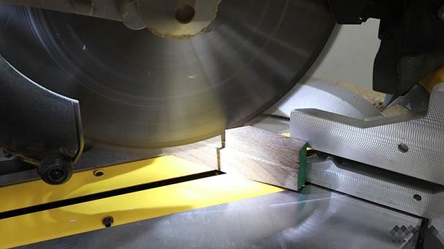 cutting trim at miter saw