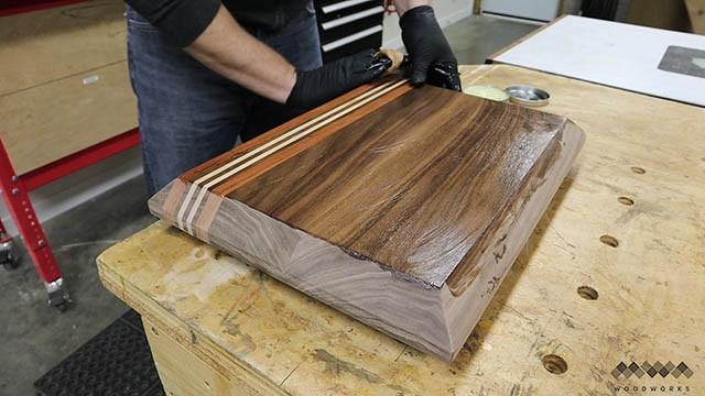 applying finish to cutting board