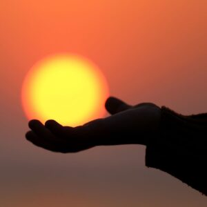 Hand holding sun image