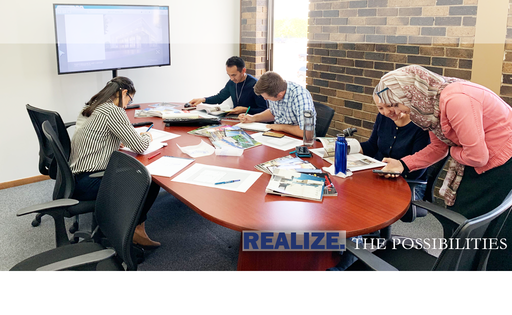 This is an image of our team working together to develop a design for a client
