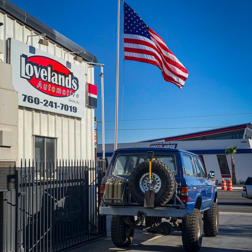 Toyota Land Cruiser exiting shop