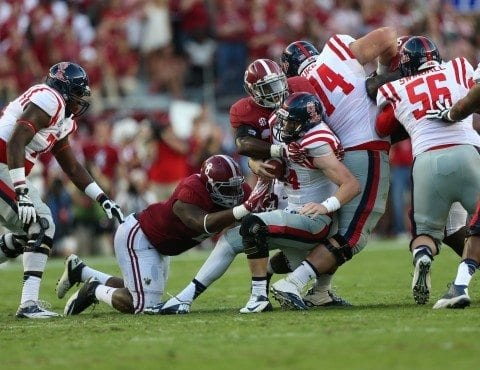 Alabama football players Jeoffrey Pagan and CJ Mosley wrap up the Ole Miss offense.
