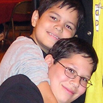 Milwaukee Christian Center Boys Hugging Donate CTA Photo