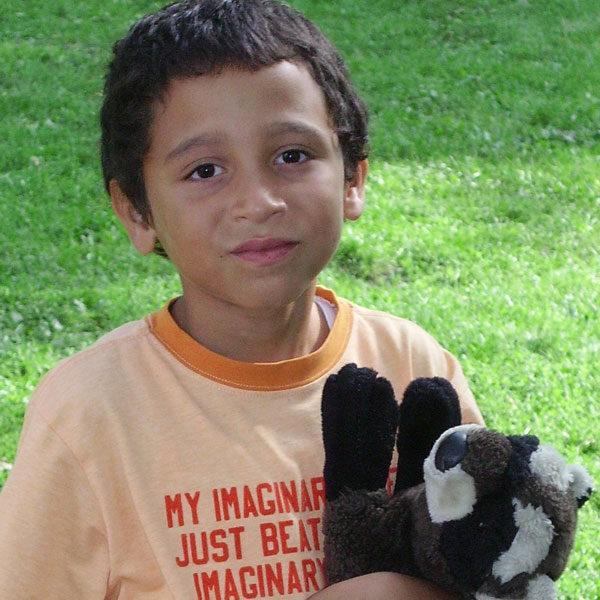 Milwaukee Christian Center Boys Hugging Volunteer CTA Photo