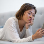 Woman on phone, scrolling