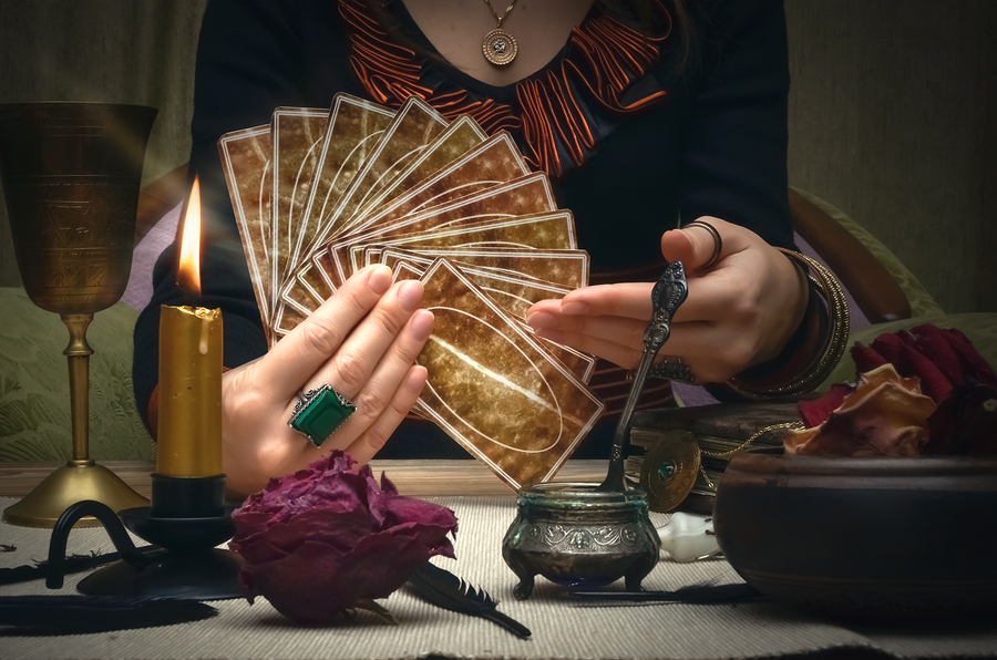 woman holding tarot cards reading fortune