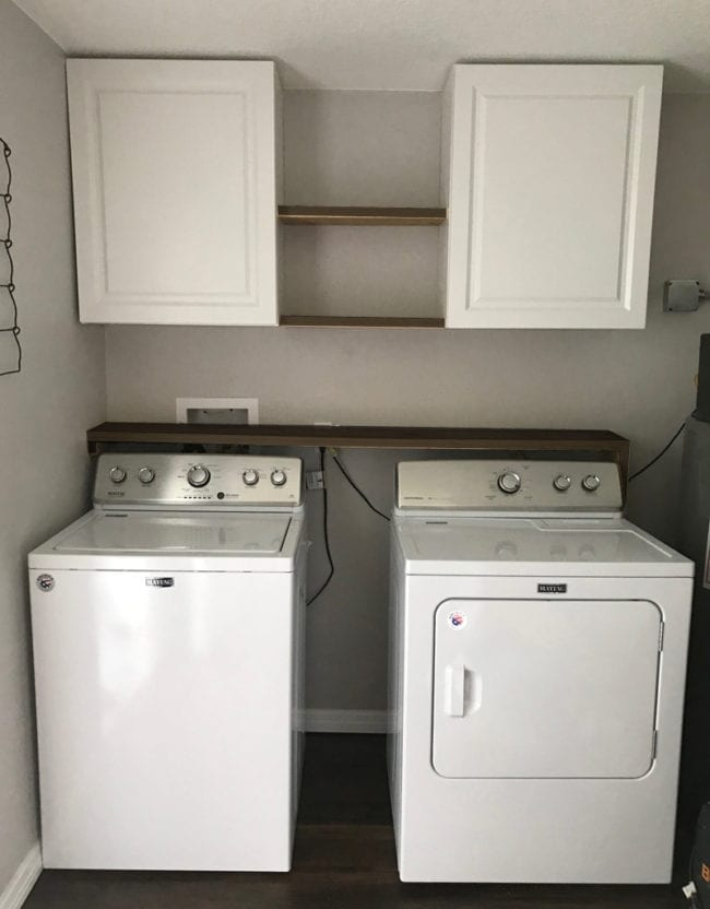Laundry Room Storage Solutions - Add cabinets and shelving above washer and dryer for storage and organization.