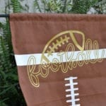 Football Yard Flag with HTV. A Silhouette project - a Cricut project. Grab the cut file, HTV and football flag to make your own.