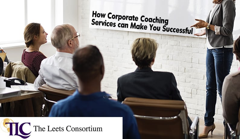 corporate coach in front of executives