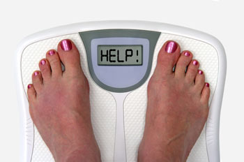 HELP me lose weight written on scale