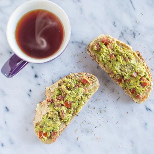 Avocado toast with tomatoes and rosemary