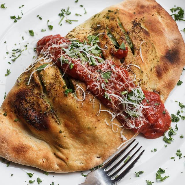 Louisiana Pizza Kitchen's Spinach & Sun-Dried Tomato Calzone