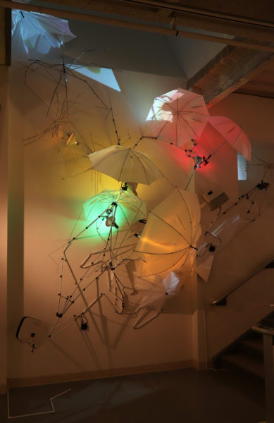 An Attempt to Communicate with the Sky Site specific Installation Umbrellas, tripods, lights, electrical cord, plastic, power strip, projectors, video dimensions variable 2019