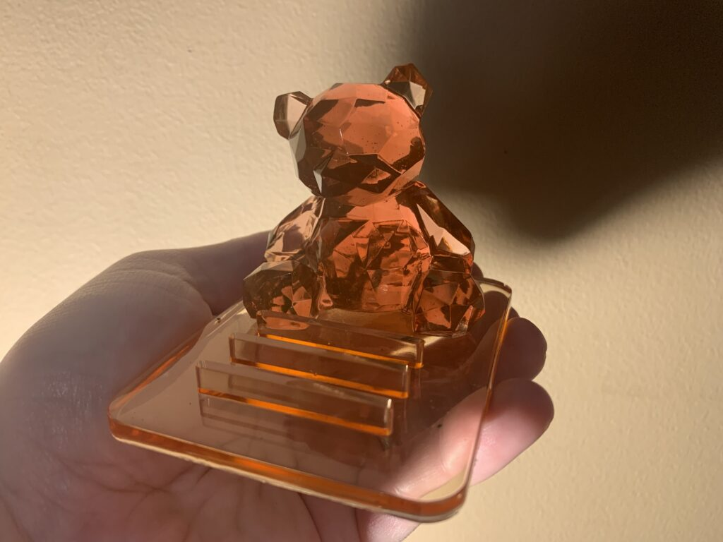 Decorative cell phone stand. The bear is removable from the platform.