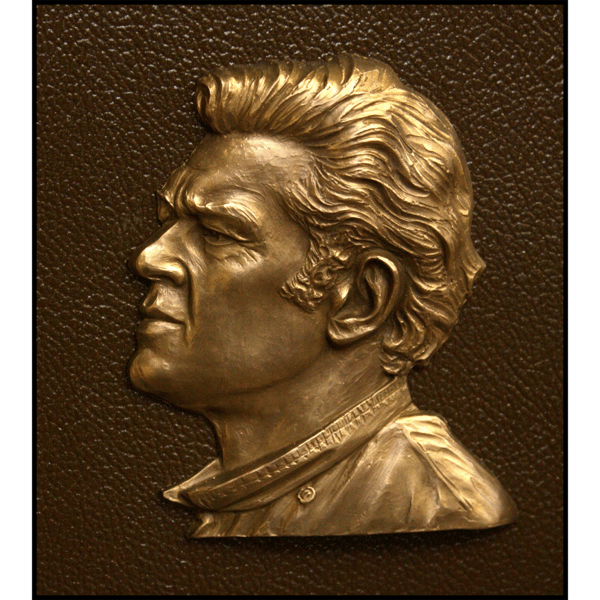 closeup photo of bronze-colored plaque with small relief portrait of Bob Jachowicz