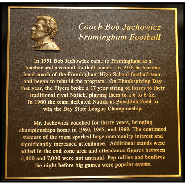 photo of bronze-colored plaque with small relief portrait of Bob Jachowicz in top left corner