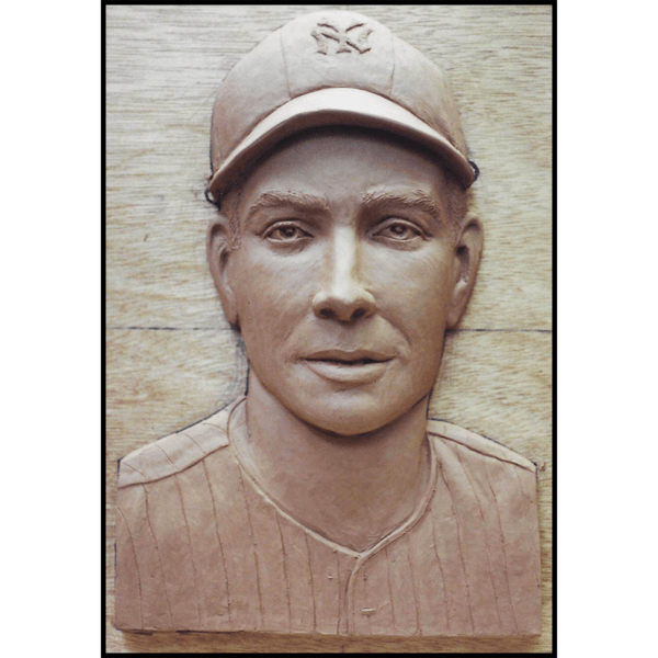 photo of clay model of portrait relief sculpture of Joe DiMaggio on wood backing