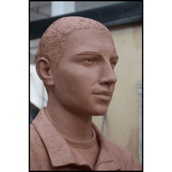 closeup photo of face of clay model of sculpture of Johnny Roberge