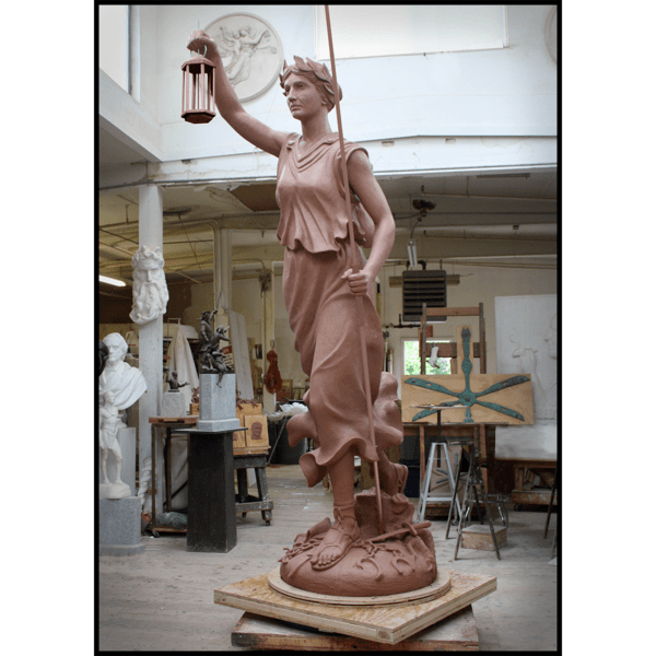 photo of clay model of statue of female representing Liberty with arm raised and holding lantern
