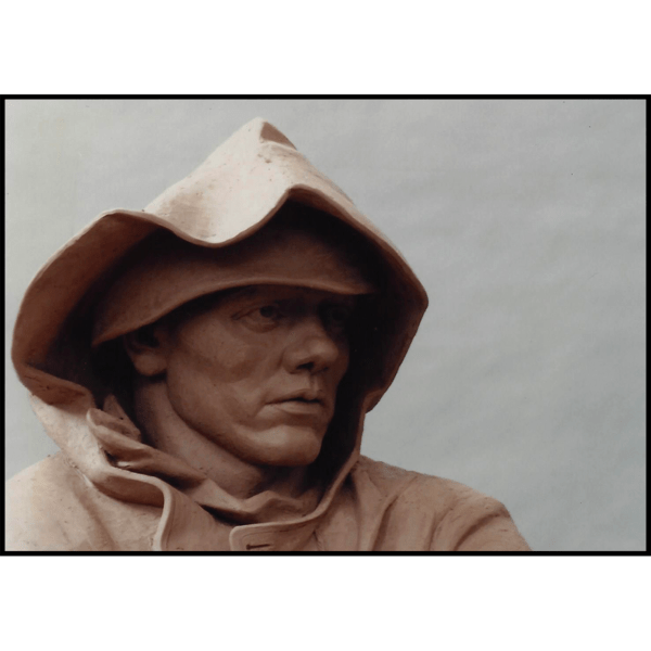 detail photo of clay model of sculpture of male American soldier wearing hood
