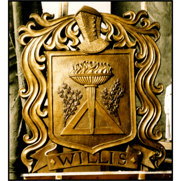 photo of bronze relief cartouche of family seal on wood easel