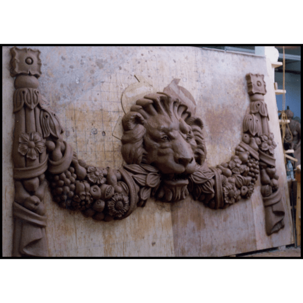 photo of clay model of ornamental sculpture for a building