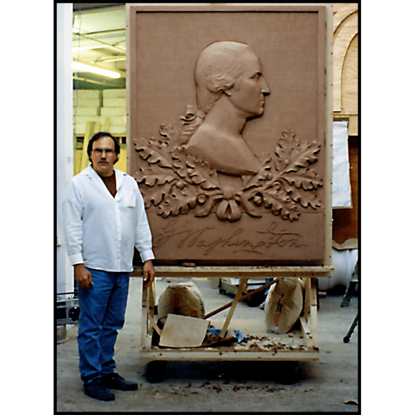 photo of clay model of sculpture relief portrait of George Washington in profile with oak leaves and his signature with sculptor Robert Shure