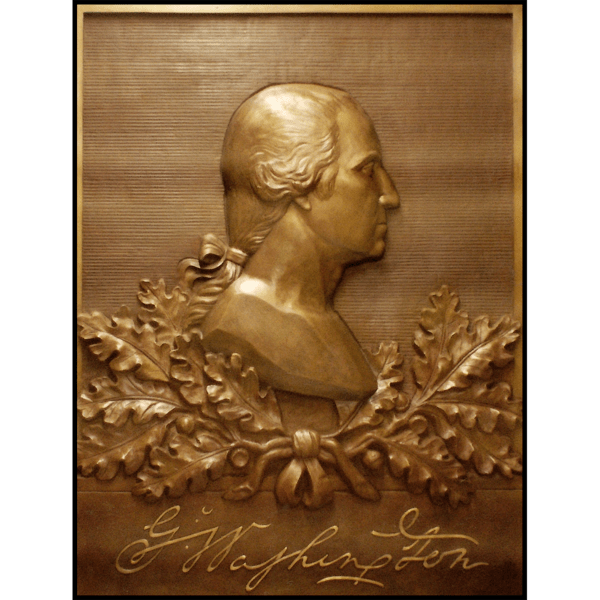 photo of bronze relief portrait of George Washington in profile with oak leaves and his signature