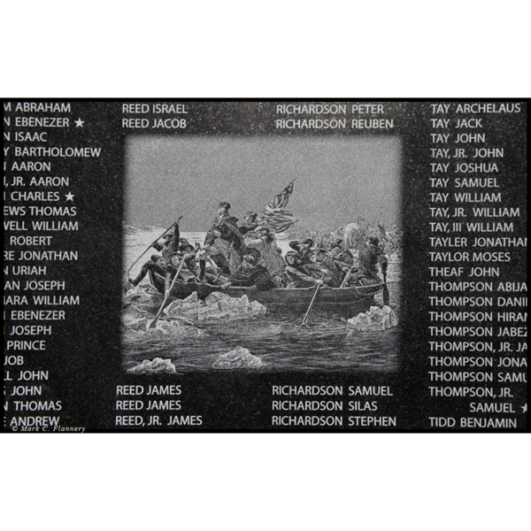photo closeup of black granite etchings on war memorial wall of veterans' names and image of painting of Washington Crossing the Delaware by Emanuel Leutze