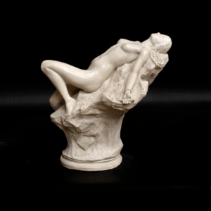 photo of white-colored Andromeda reduction sculpture featuring a female laying with her back against a rock
