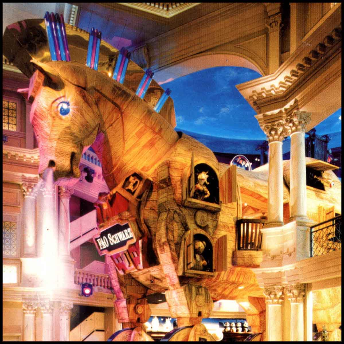photo of large Trojan Horse sculpture with toys in windows and doors, serving as a store, inside Caesars Palace