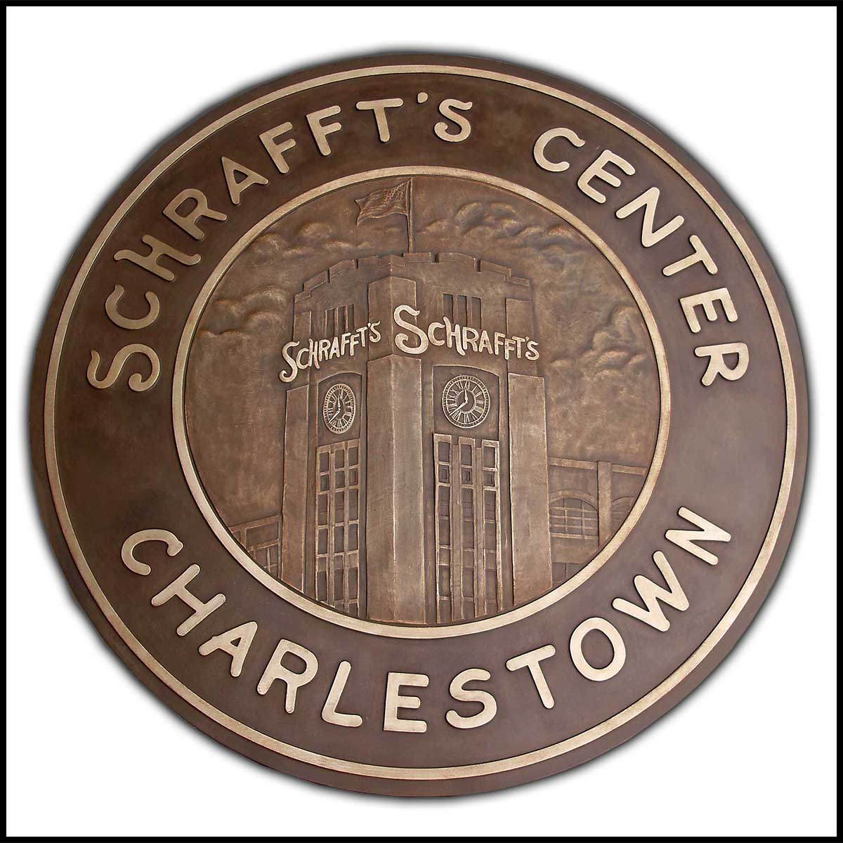 photo of bronze floor medallion with relief sculpture of Schrafft's building and text