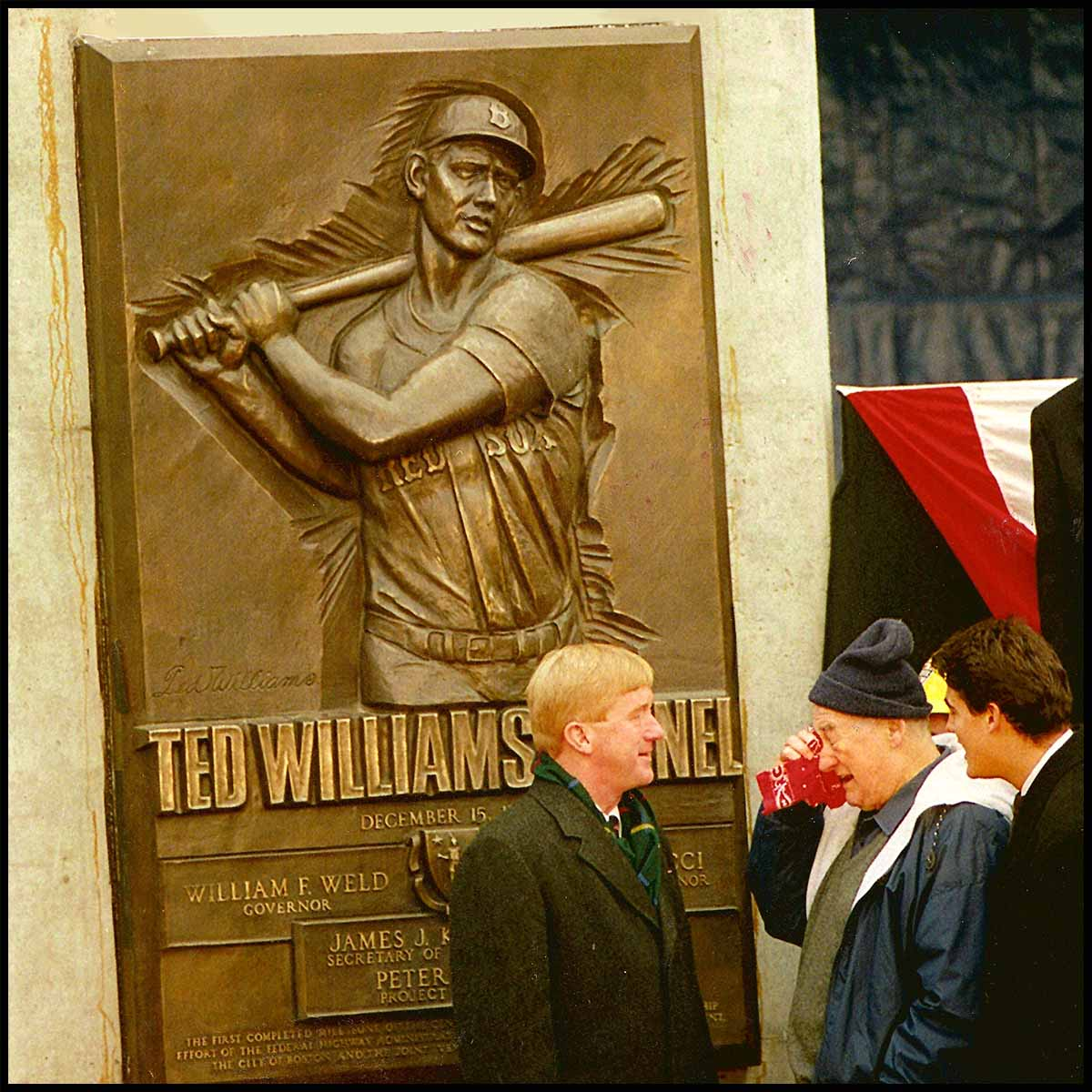 photo of bronze relief of Ted Williams batting with people at dedication