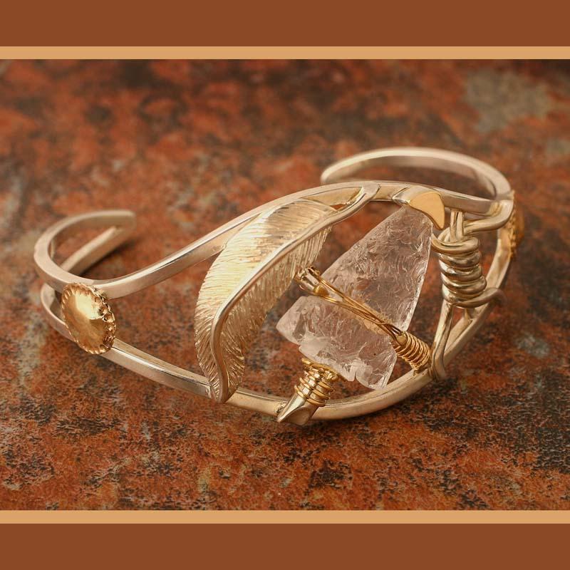 sterling silver and 14 karat gold Qtz bracelet