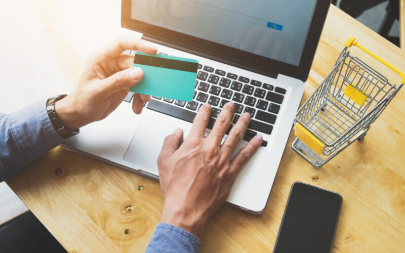 Shopping online use credit card to pay online.Vintage tone, Retro filter effect. Business online shopping and sale concept .
