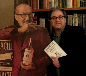 Author Robert Bader poses next to a promotional standup of Groucho Marx that is part of his collection. (Photo courtesy Robert Bader)