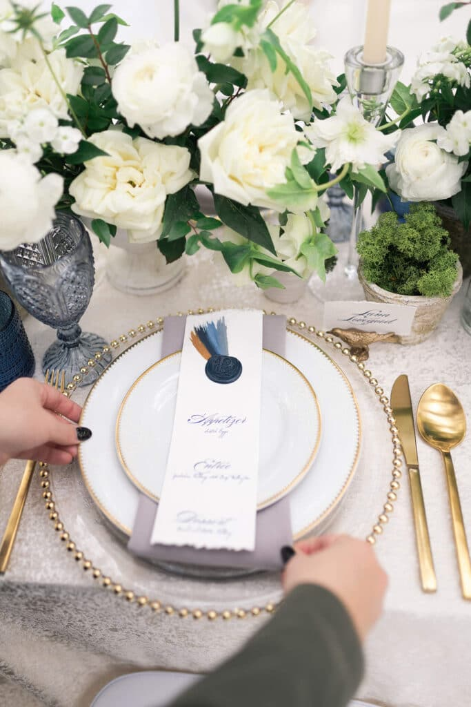 wedding planner placing a table setting at a micro and intimate wedding at the Oak Atelier in Houston Texas by Swish and Clicl Photography