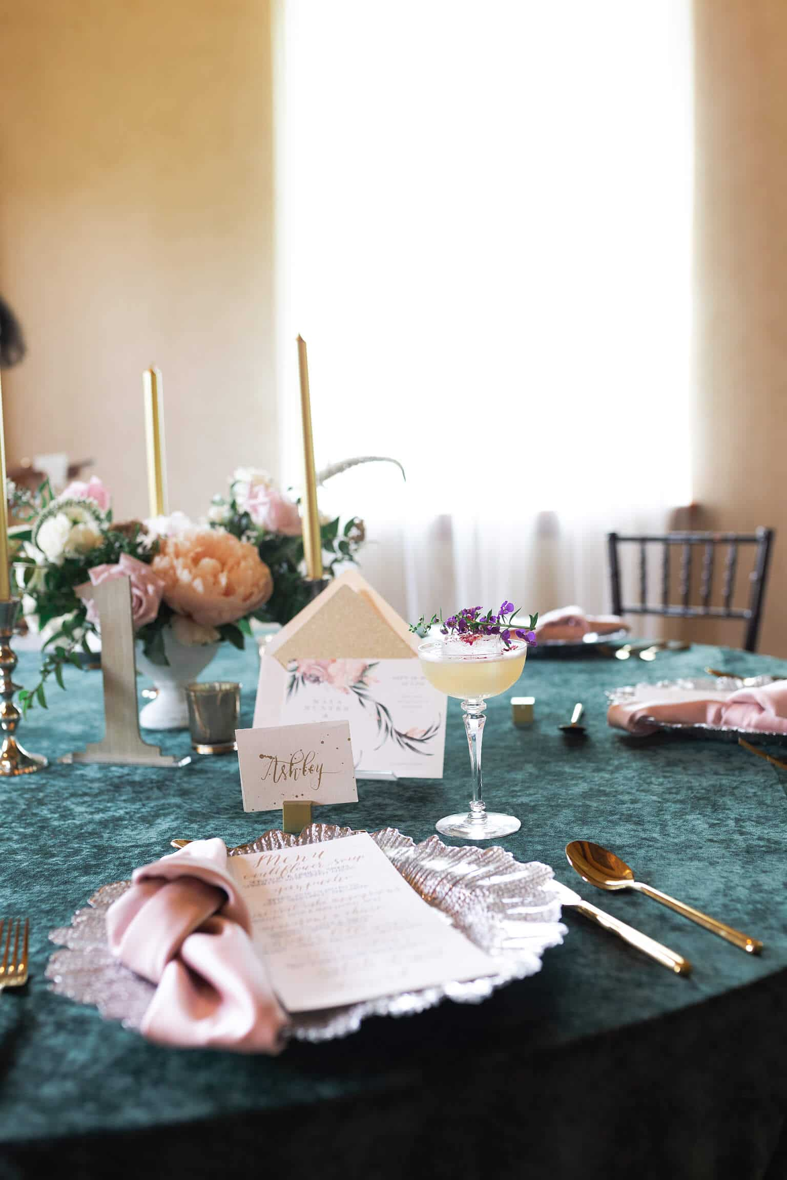 table setting with cocktails and a wedding invitation at a micro and intimate wedding at Balmorhea Event Venue in Houston Texas by Swish and Click Photography