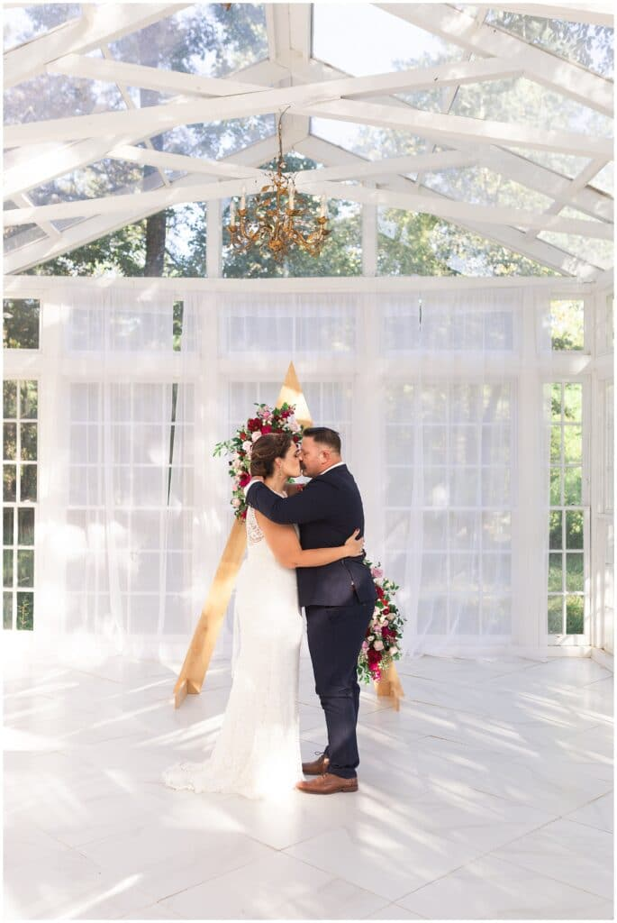 Oak Atelier elopement first kiss captured by Swish and Click Photography in Houston Texas