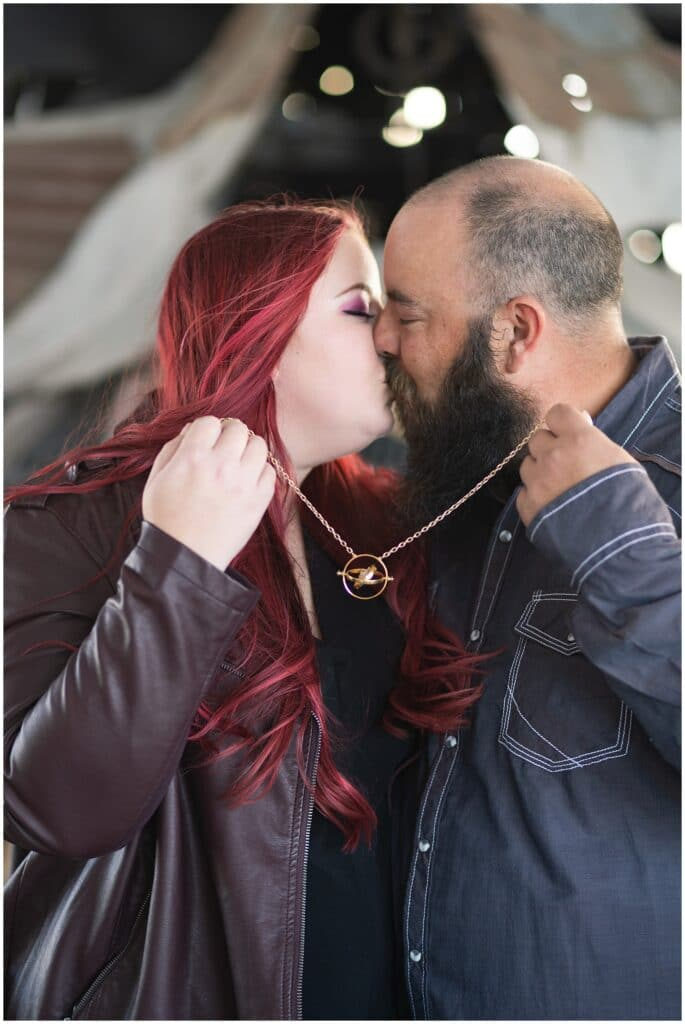 engaged Houston couple use Harry Potter time turner at St Arnold's brewery by Swish and Click Photography