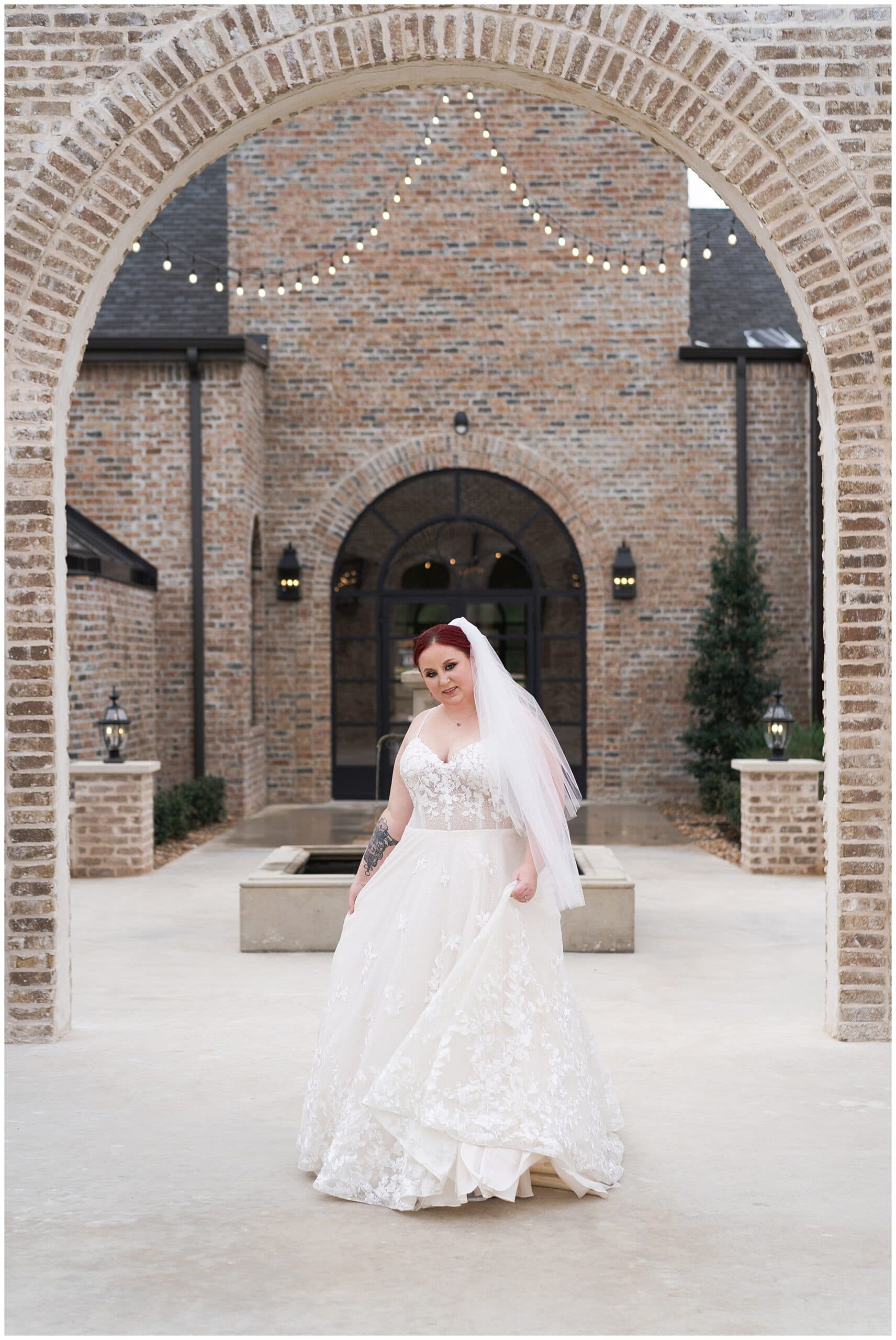 bride plays with her gown during her Houston bridal session at Iron Manor captured by Swish and Click Photography