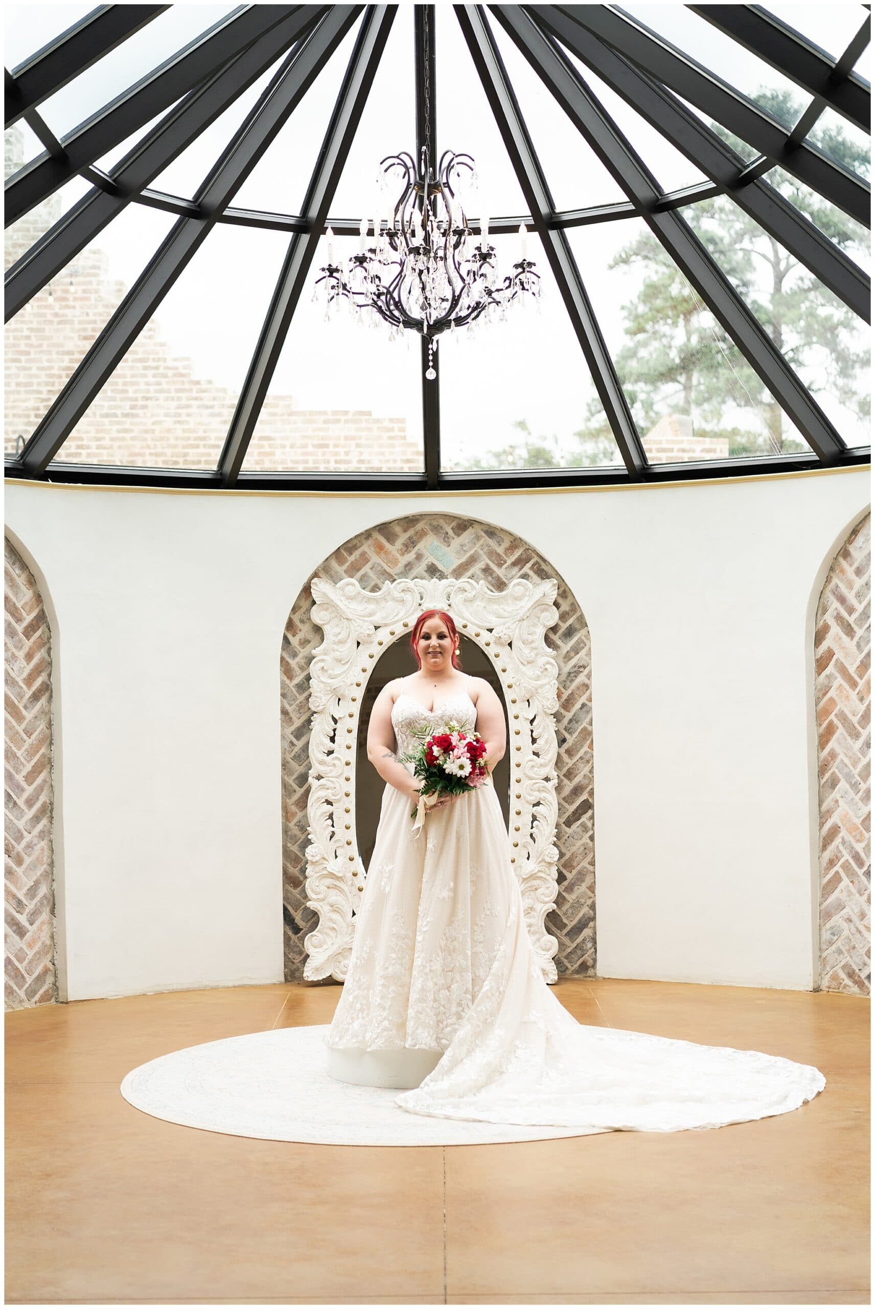 bride poses during her Houston bridal session at Iron Manor captured by Swish and Click Photography