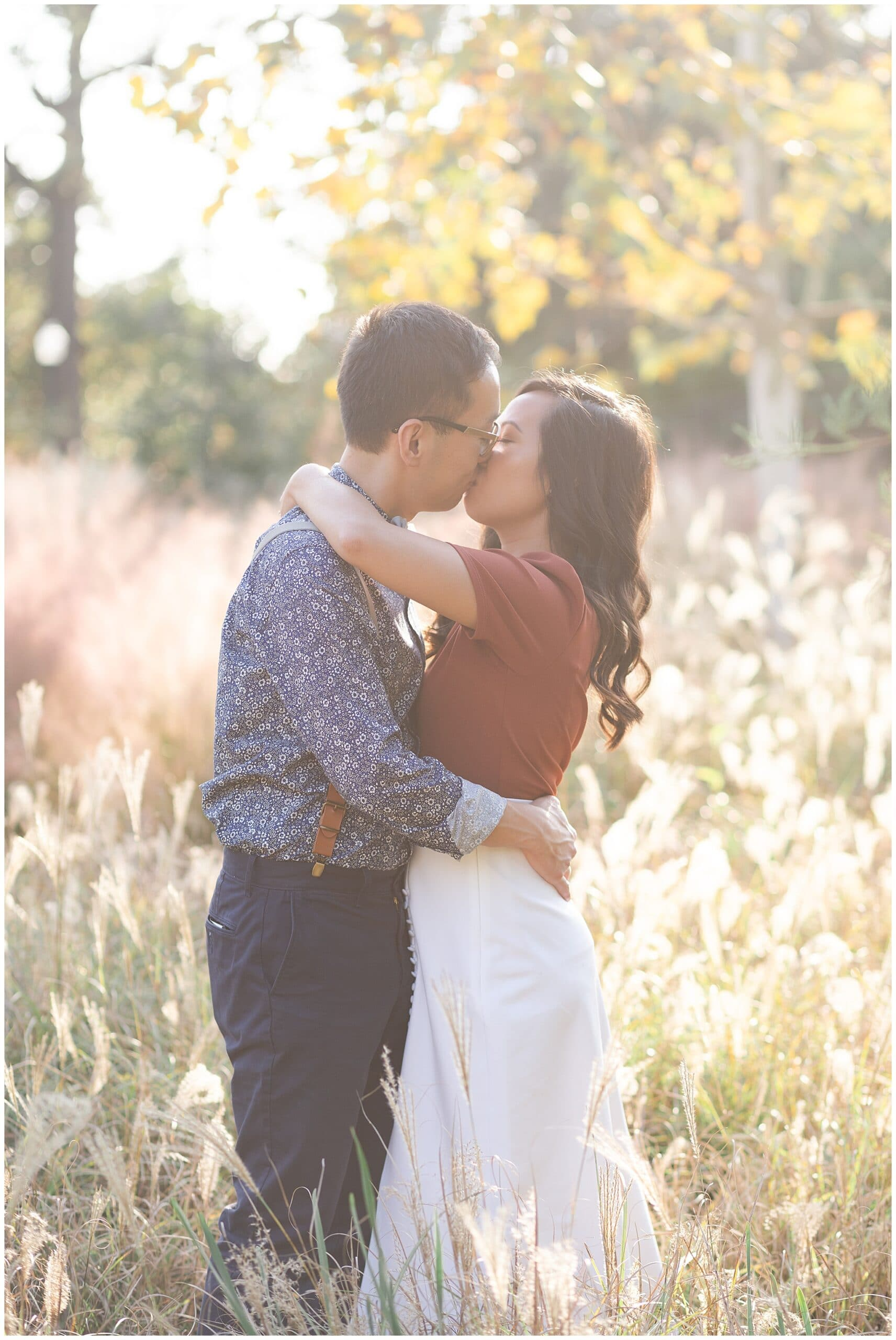 engaged couple kisses during Houston engagement session at McGovern Centennial Gardens by Swish and Click Photography