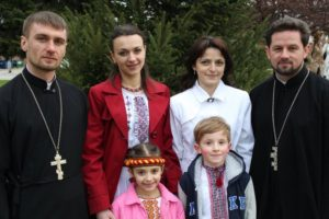 Fr. Mykola, Fr. Volodymyr, and their families in 2011.