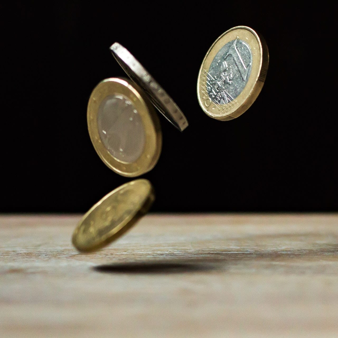 coins falling on table