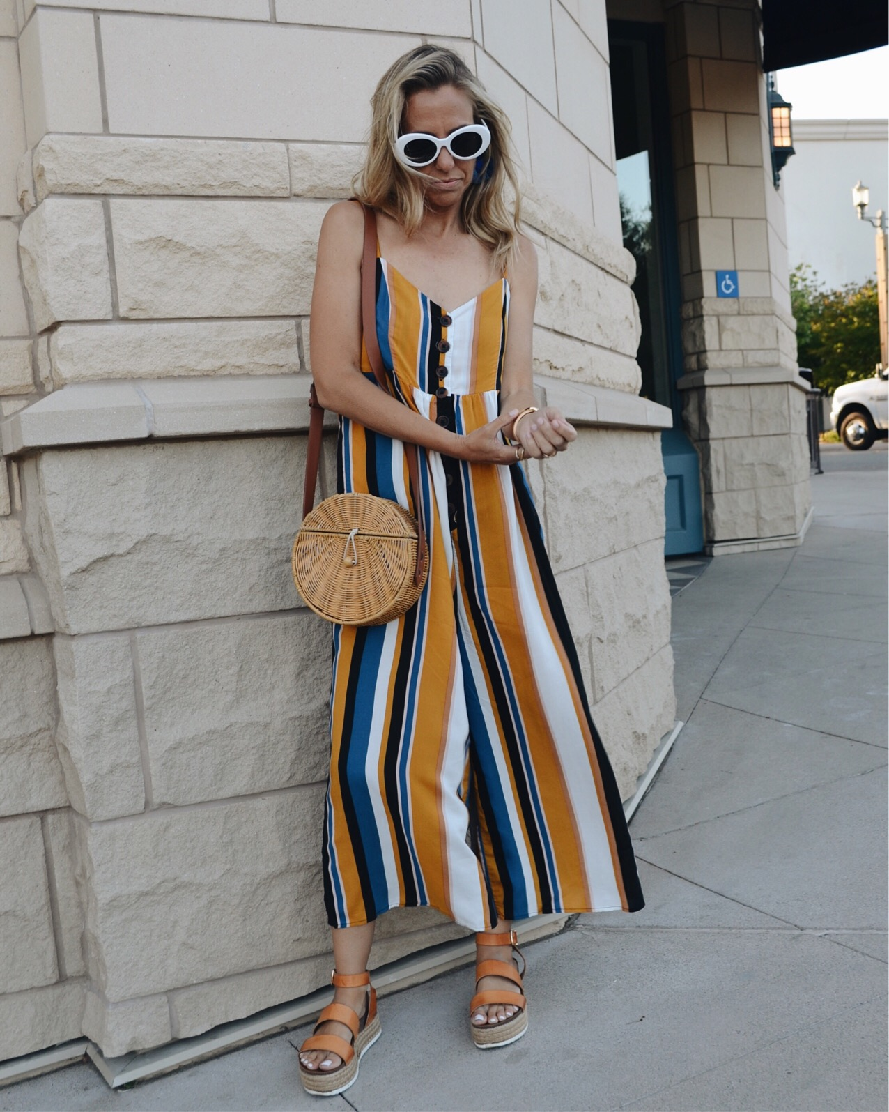 THE MUST HAVE SHOE TREND-PLATFORMS- Jaclyn De Leon Style - striped jumpsuit + woven handbag + espadrille sandals + retro style sunglasses + what to wear this summer + casual street style + DSW