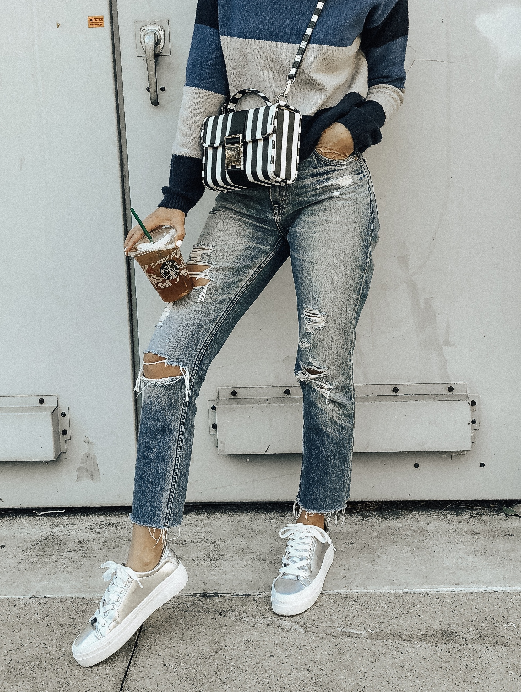 NOVEMBER TOP 10- Jaclyn De Leon Style + high rise mom jeans + abercrombie denim + distressed high rise jeans + casual street style + platform sneakers + mom style + starbucks + striped sweater + what to buy this season + top selling items