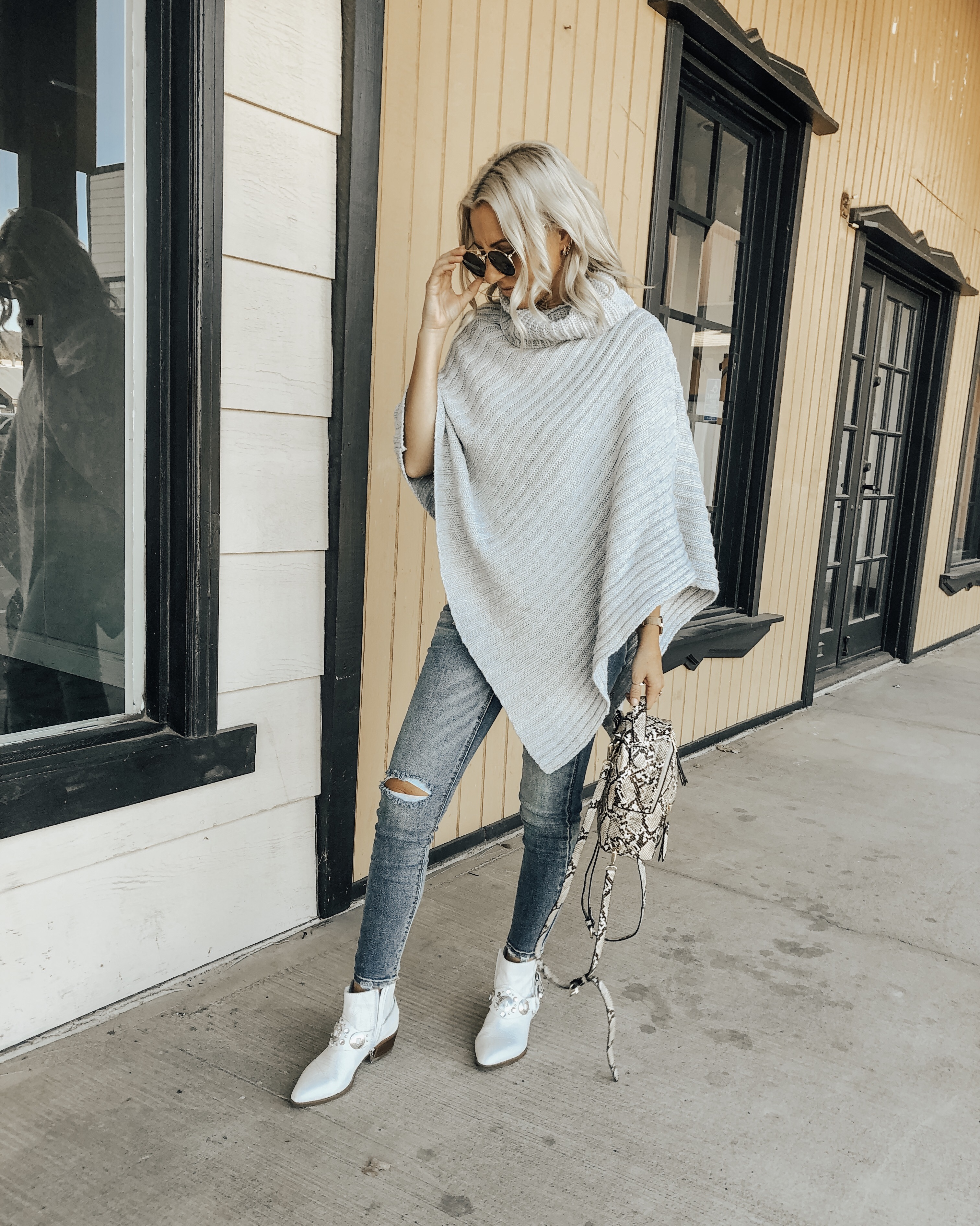 TREND ALERT: THE PONCHO SWEATER- Jaclyn De Leon Style + the poncho sweater trend is back in a big way! It's comfy + cozy and the perfect piece to throw over a top and jeans to completely update your look. This Amazon find is a must- have piece
