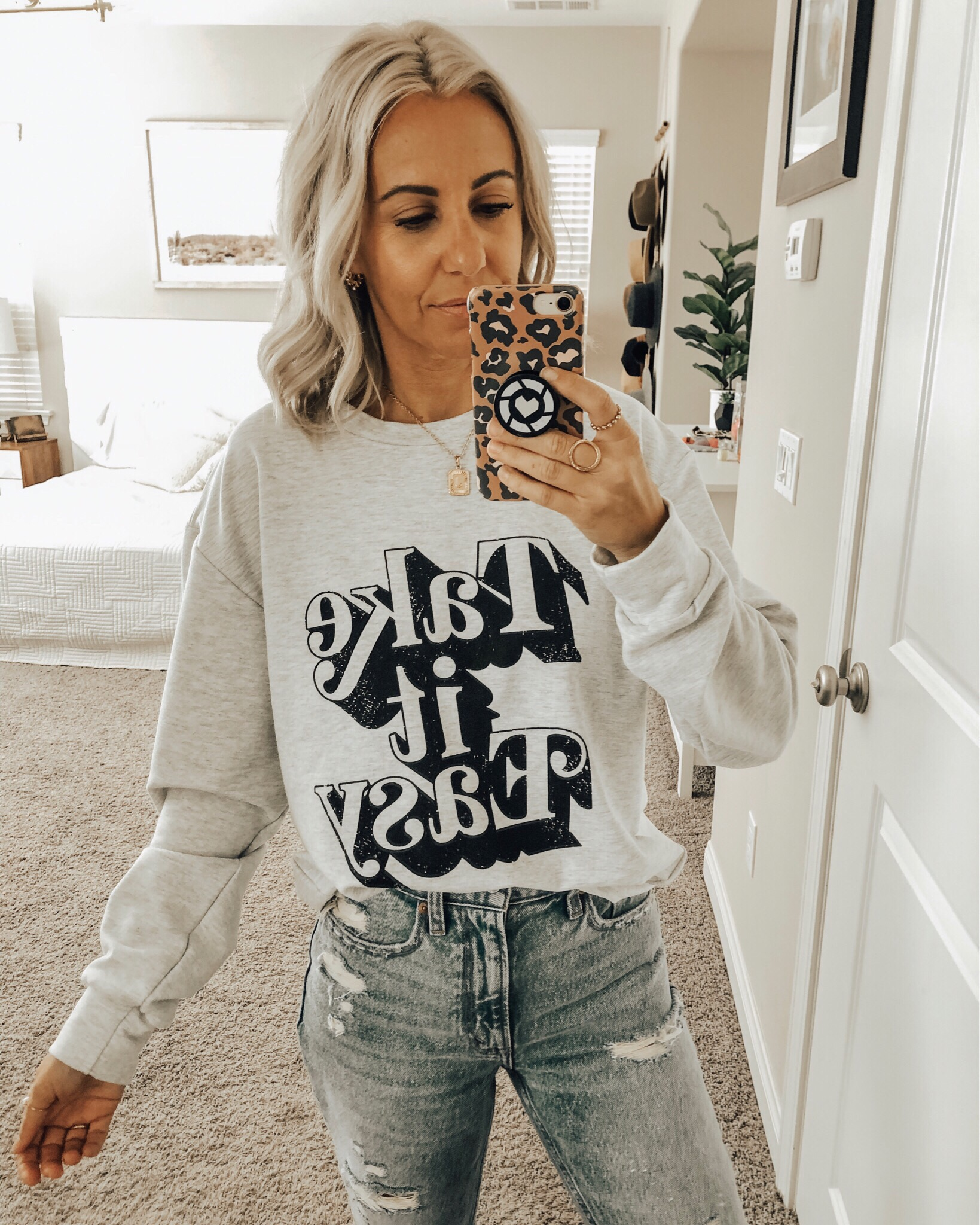 OCTOBER TOP 10- Jaclyn De Leon Style + Sharing the best selling items from the month of October which include a leopard sweater, huggie hoop earrings, graphic tees + sweatshirts, faux fur slippers, striped sweaters, western booties and denim